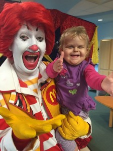 Ronald holding a child with outstretched arms